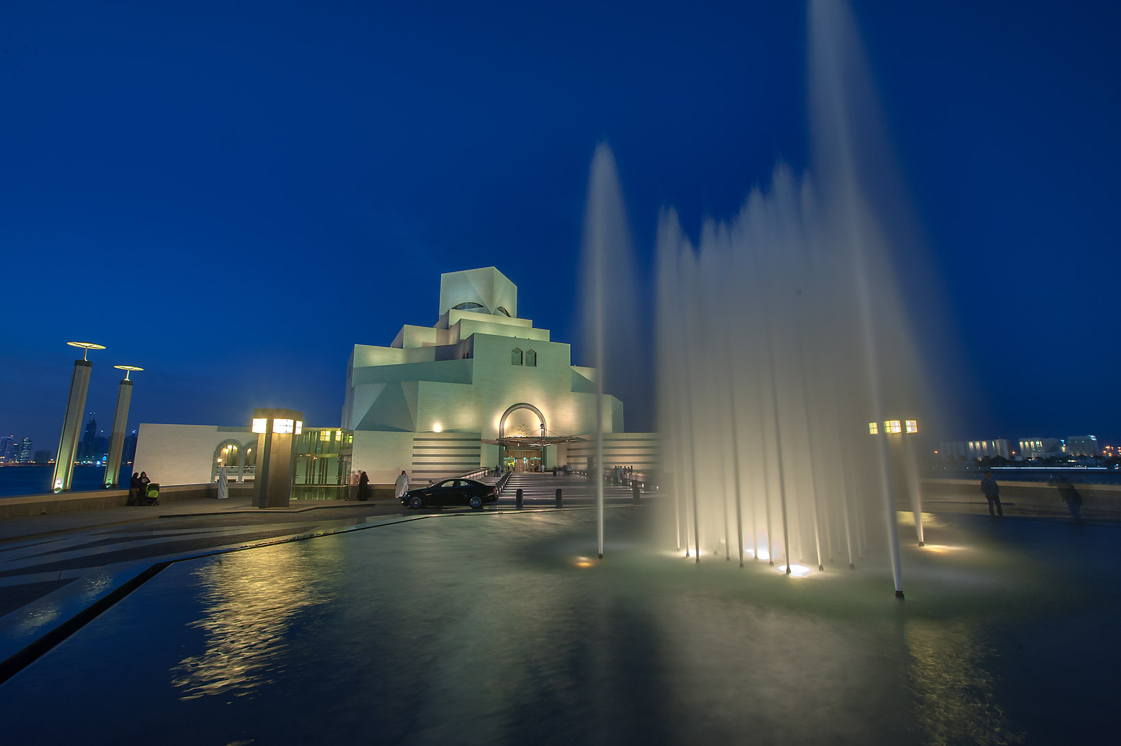 Illumination of water fountain in front of Museum of Islamic Art. Doha, Qatar