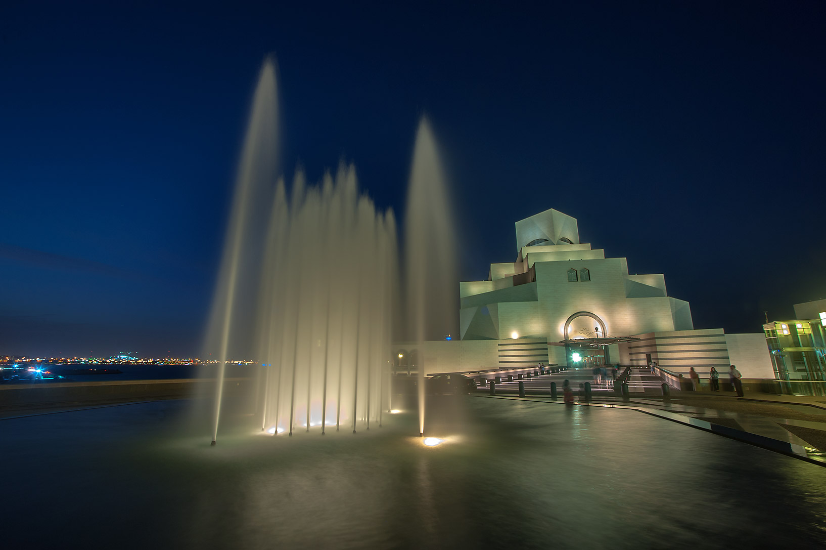 Water fountain in front of Museum of Islamic Art at evening. Doha, Qatar