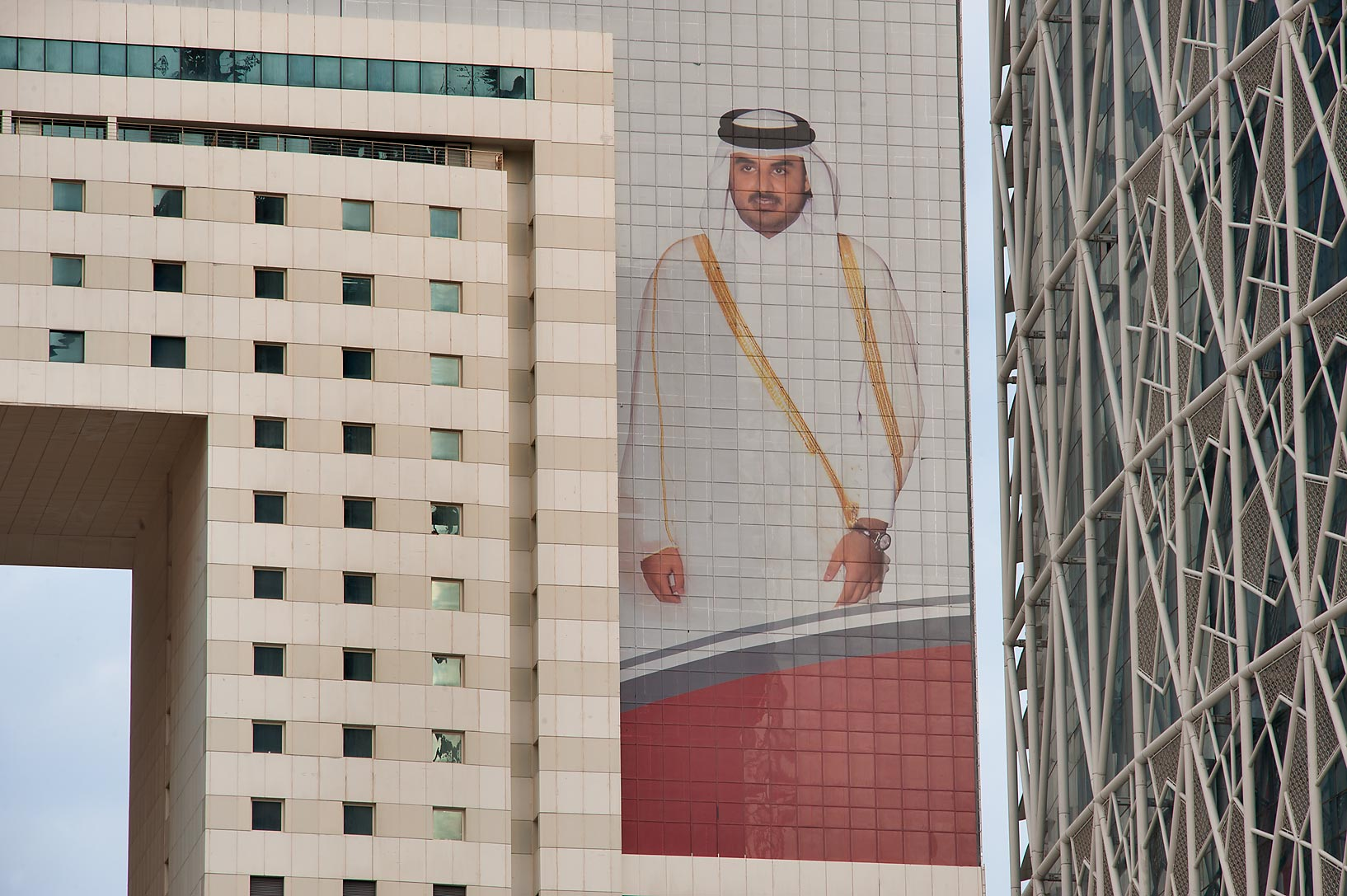 Giant portrait of emir Tamim bin Hamad Al Thani...Ezdan Tower in West Bay. Doha, Qatar