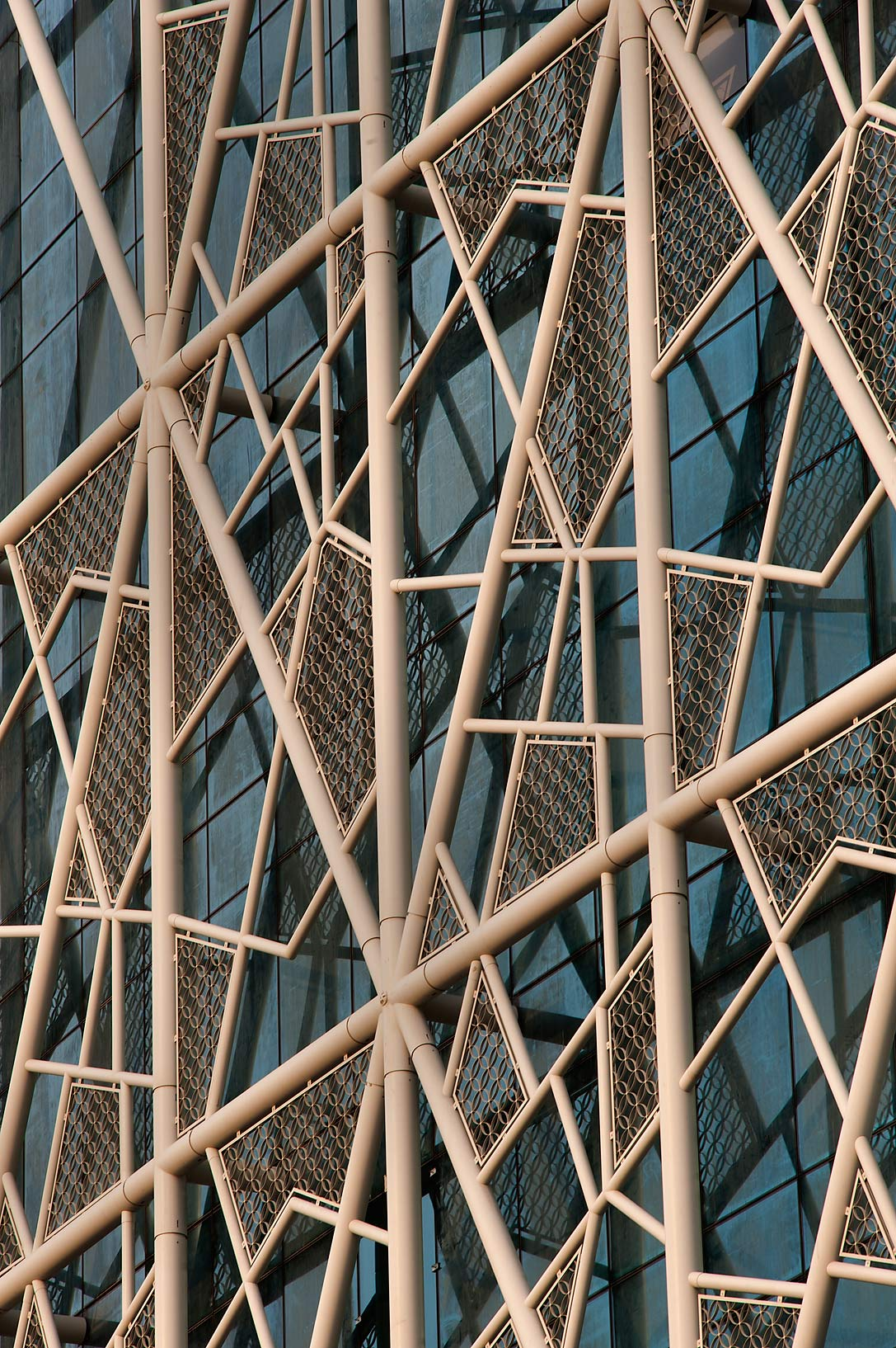 Metal latticework of QP Building from Al Adaid St. in West Bay. Doha, Qatar
