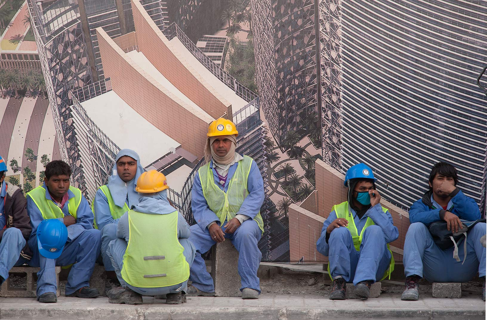 Workers on construction of QP Building waiting a...Al Adaid St. in West Bay. Doha, Qatar