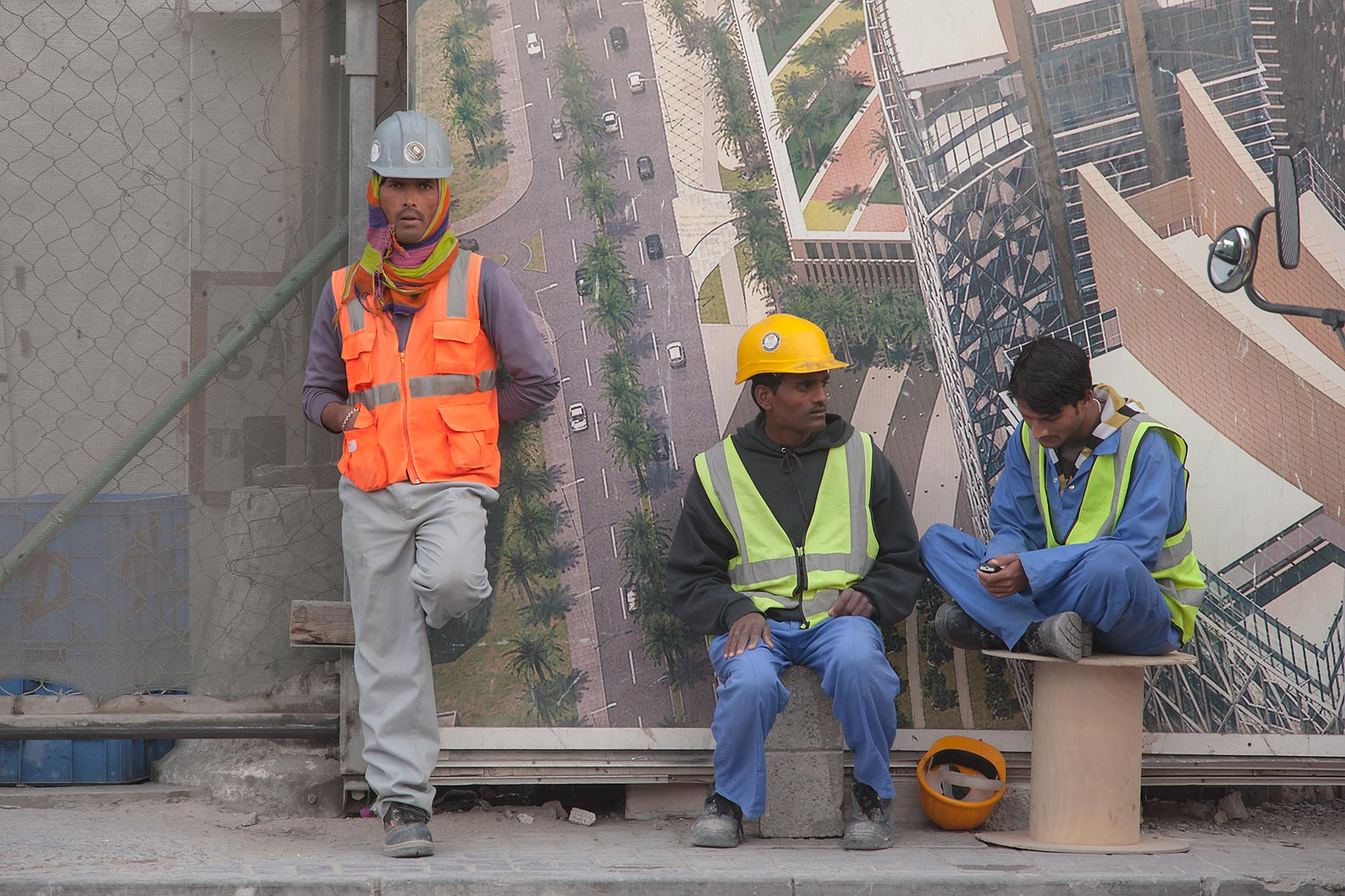 Workers on construction of QP Building after a...Al Adaid St. in West Bay. Doha, Qatar