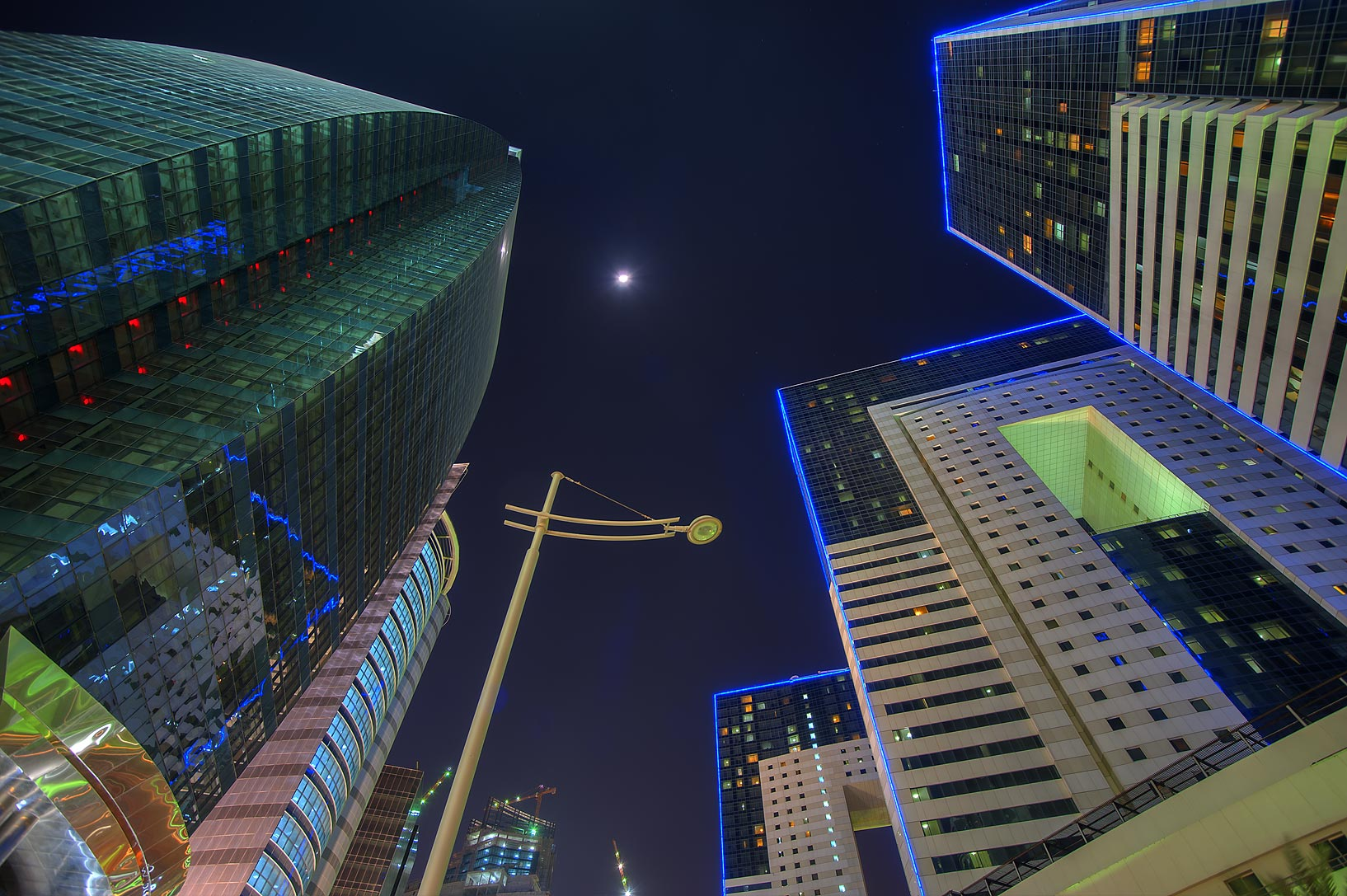 Ezdan Hotel and 'Pregnant' Tower at Al Betra St. in West Bay. Doha, Qatar