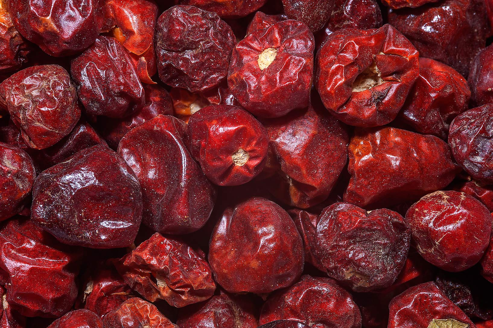 Dry rose hips for sale in spice section of Souq Waqif (Old Market). Doha, Qatar