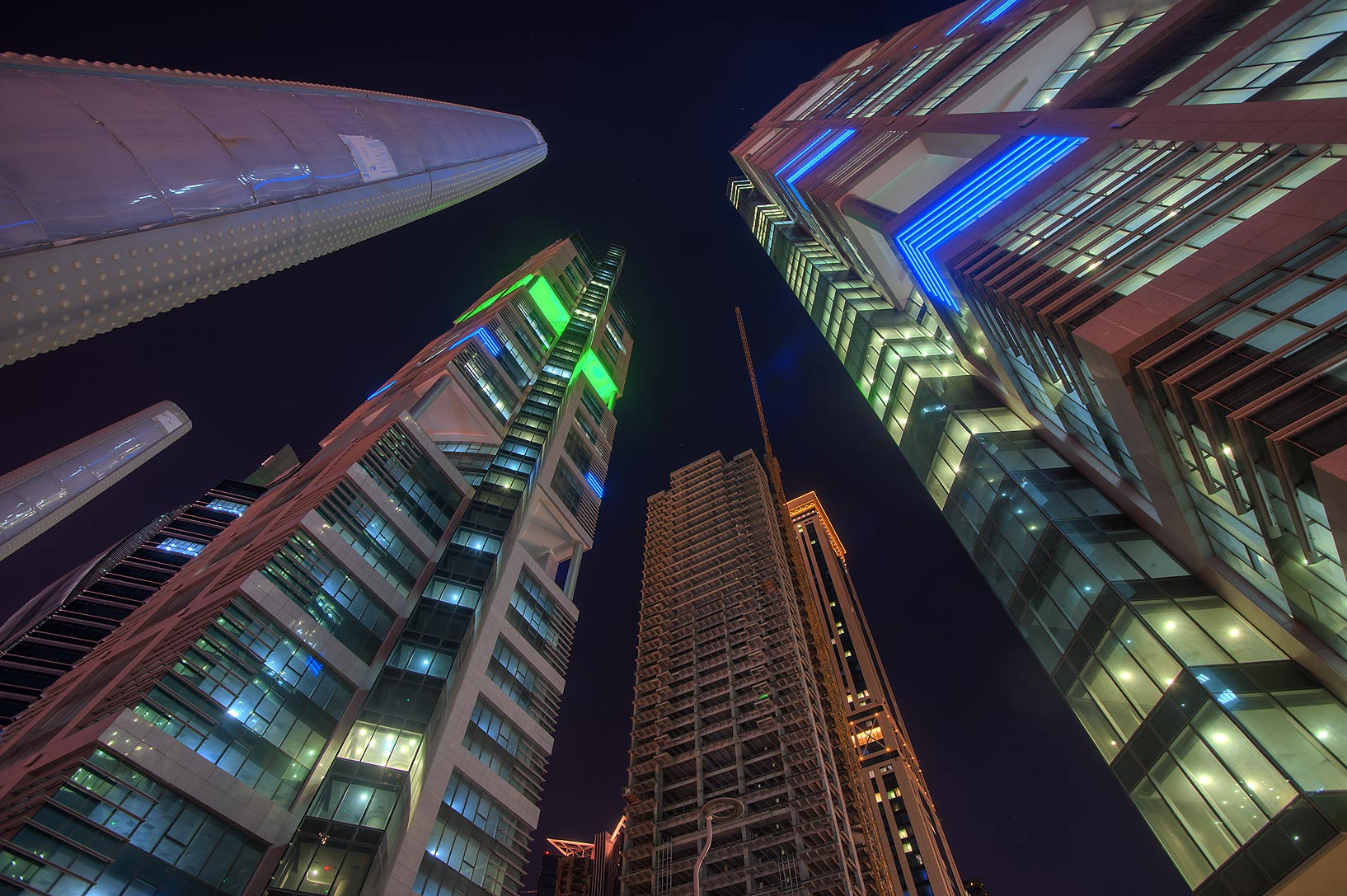 Towers at Conference Center St. in West Bay, looking up. Doha, Qatar