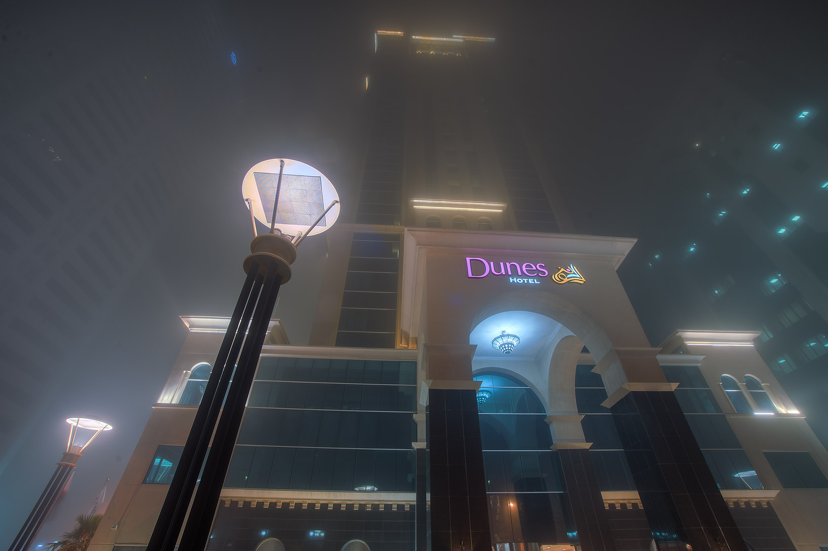 Entrance of Dunes Hotel in West Bay in fog. Doha, Qatar