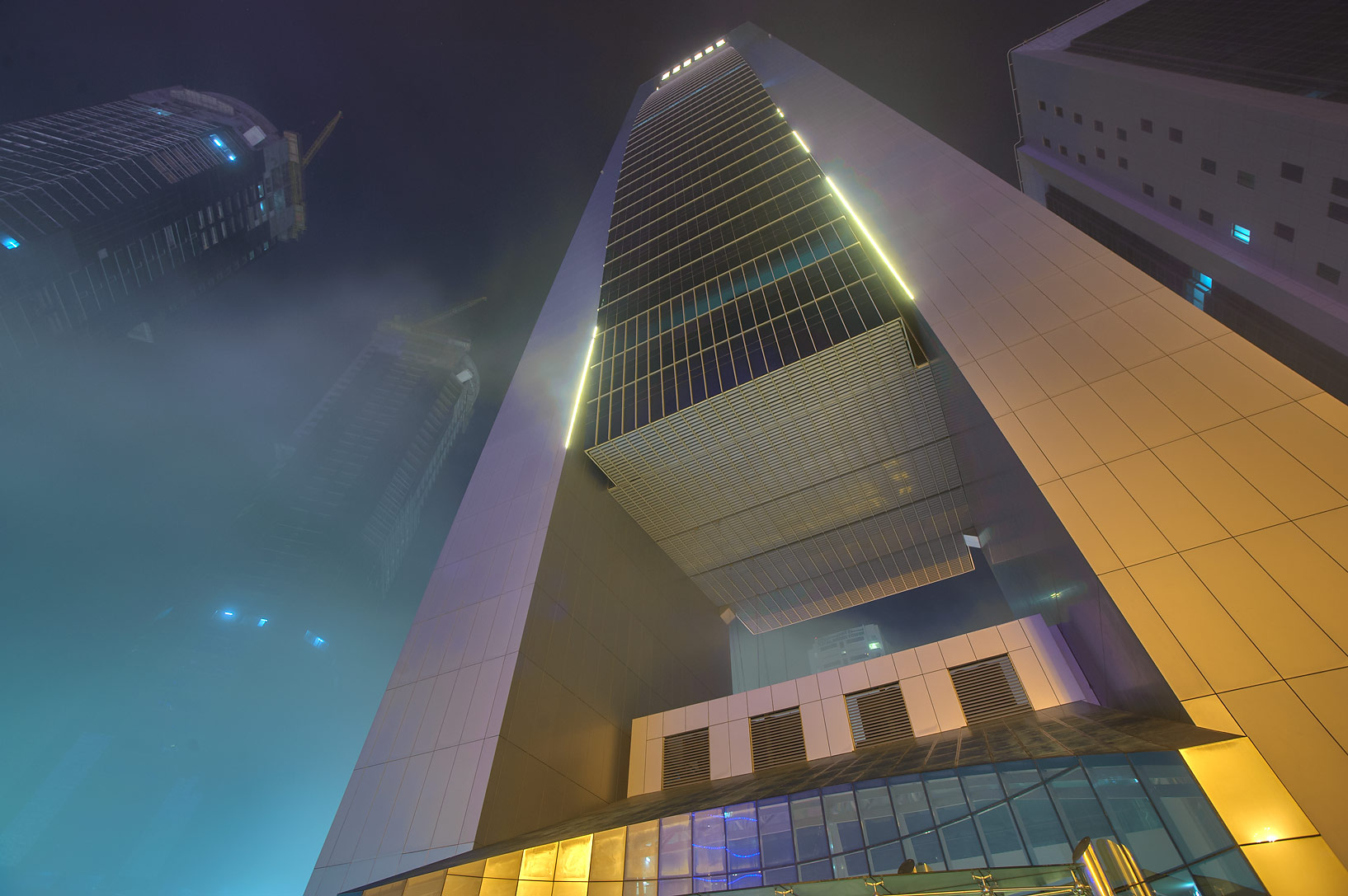 Foot of Faisal Tower in West Bay in fog. Doha, Qatar