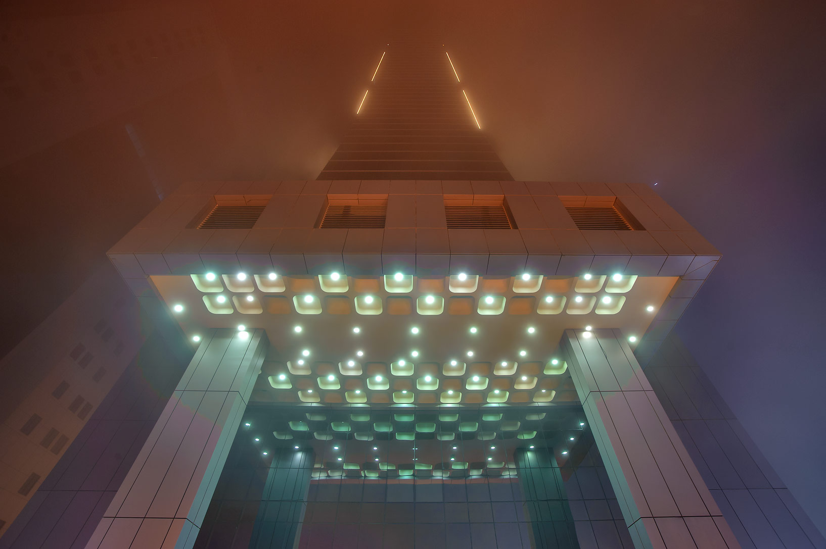 Foot of Faisal Tower in West Bay in fog at morning. Doha, Qatar