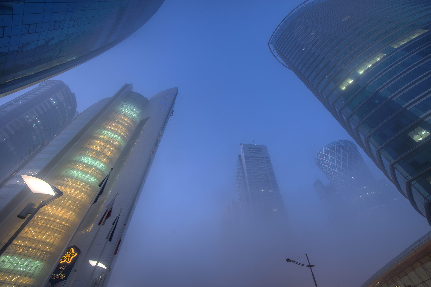 Nakheel and Al Fardan towers in West Bay in fog. Doha, Qatar