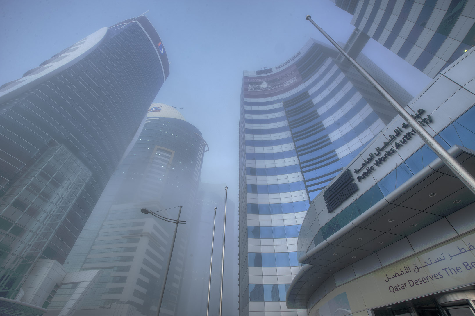 Area of Public Works Authority in West Bay in fog. Doha, Qatar