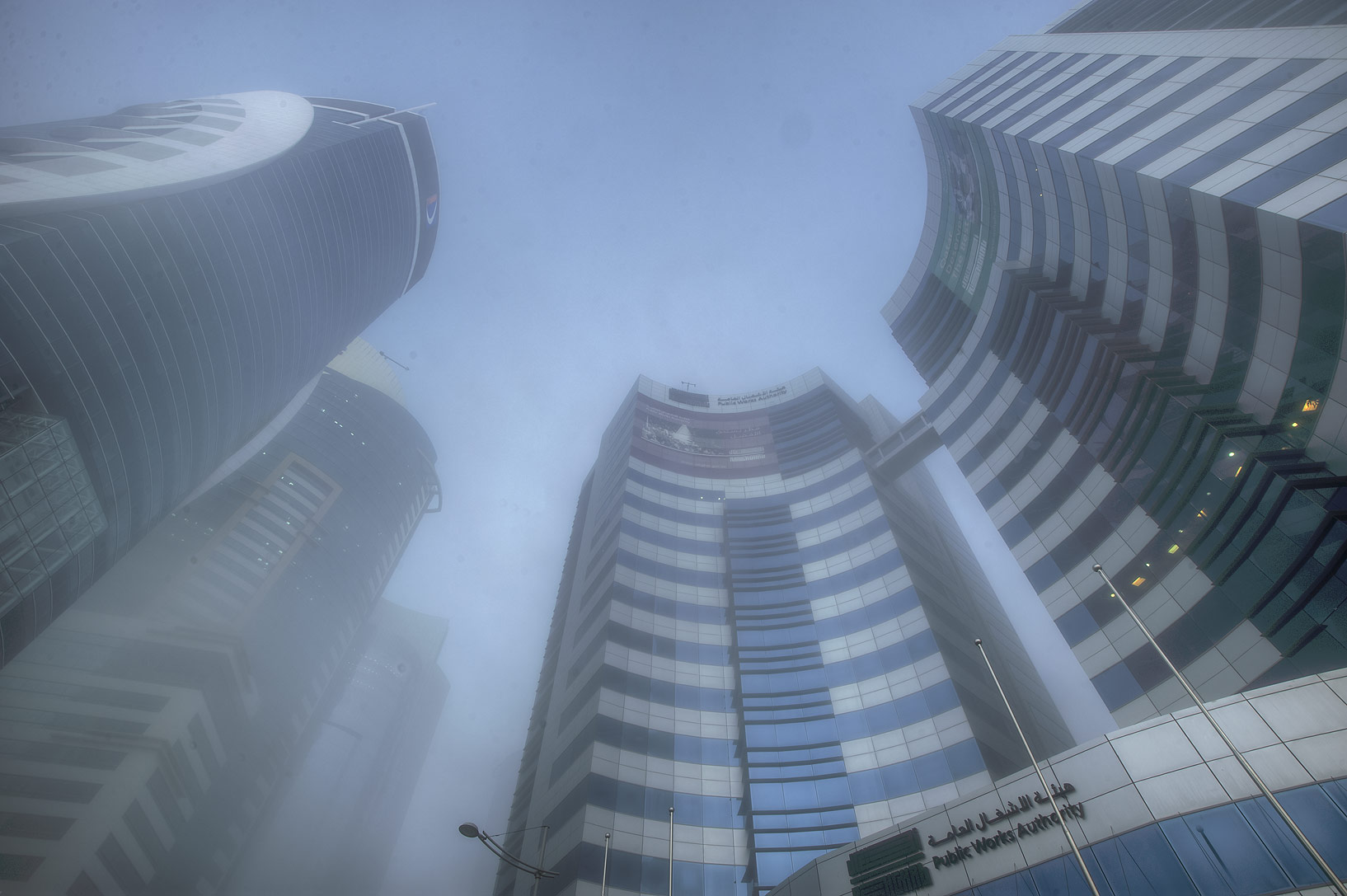 Public Works Authority in West Bay in fog, looking up. Doha, Qatar