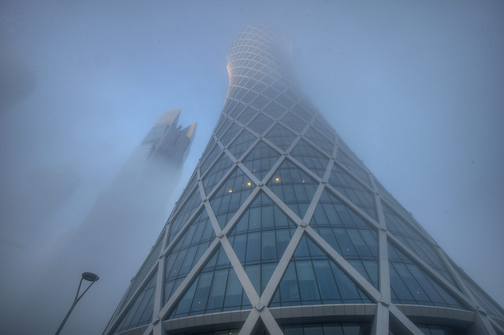 Foot of Tornado Tower in West Bay in fog. Doha, Qatar