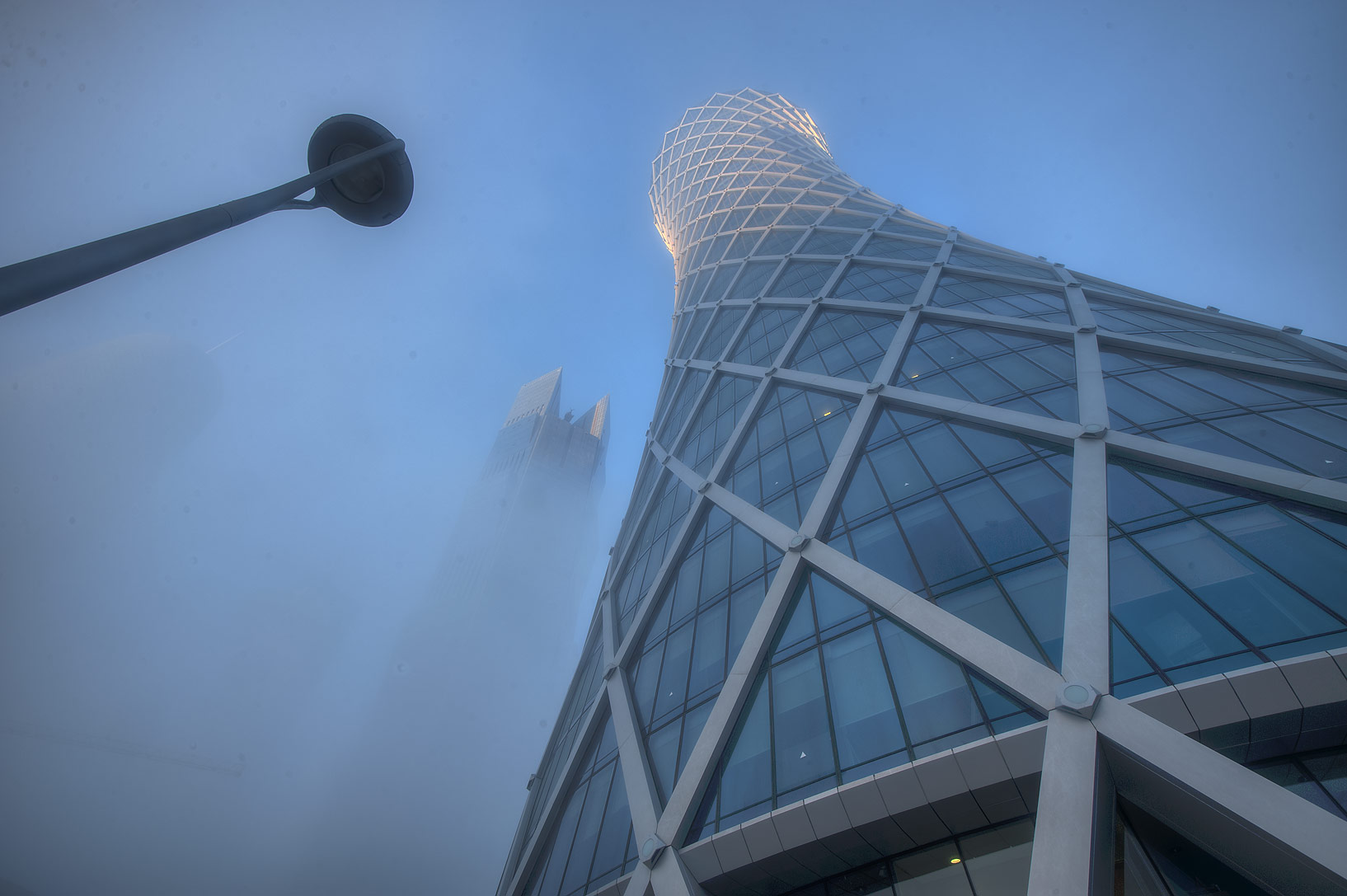 Foot of Tornado Tower in West Bay at morning in fog. Doha, Qatar
