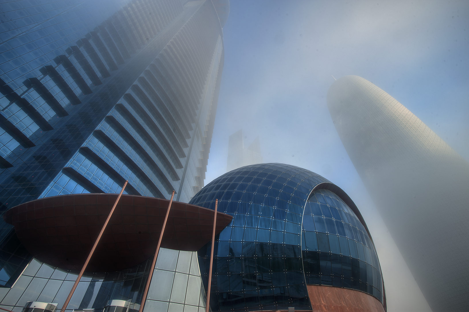 WTC and Burj Qatar Towers in West Bay in fog, at morning. Doha, Qatar