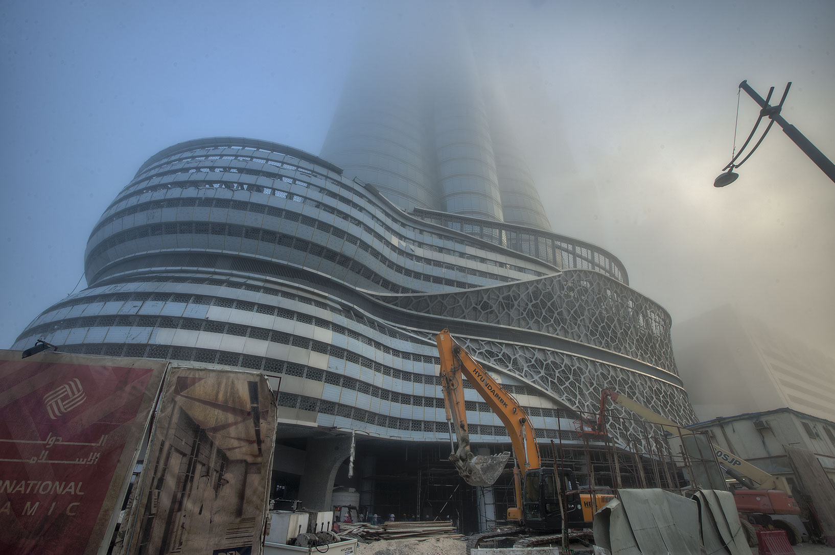 Foot of International Islamic Tower in West Bay in fog. Doha, Qatar