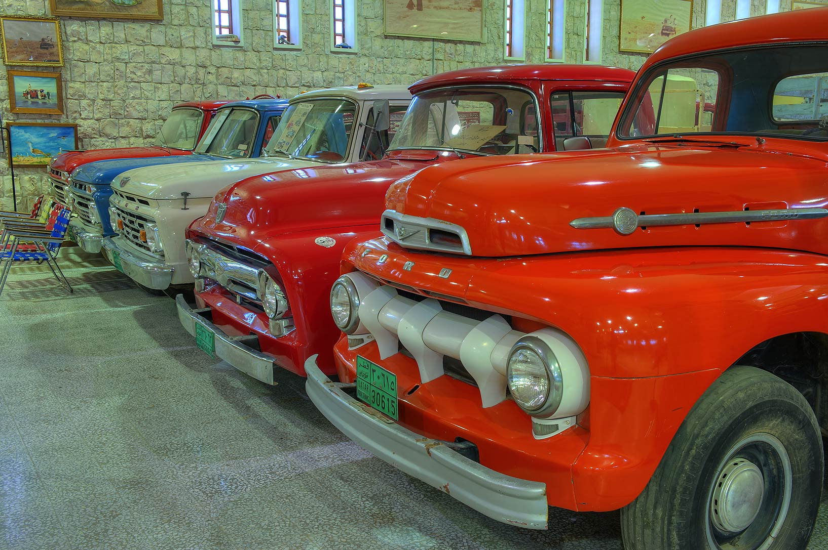 Vintage orange Ford cars in Sheikh Faisal Bin...Museum near Al-Shahaniya. Doha, Qatar