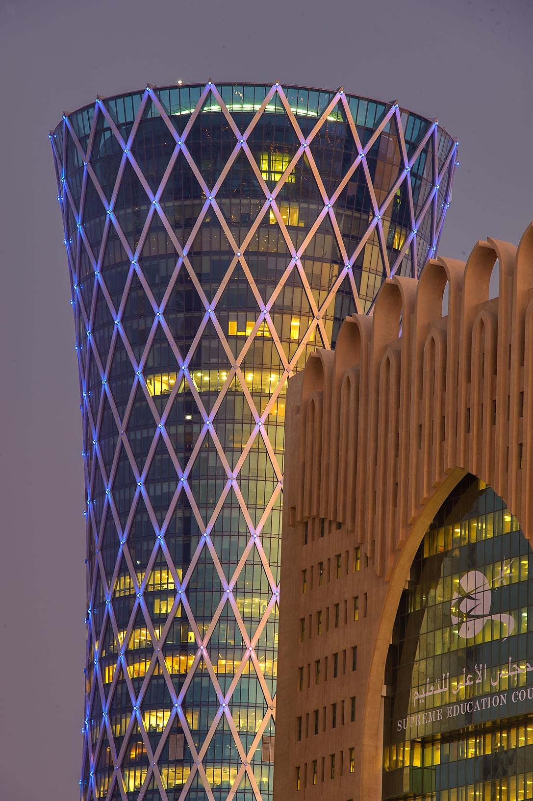 Tornado Tower and Supreme Education Council in West Bay at evening dusk. Doha, Qatar
