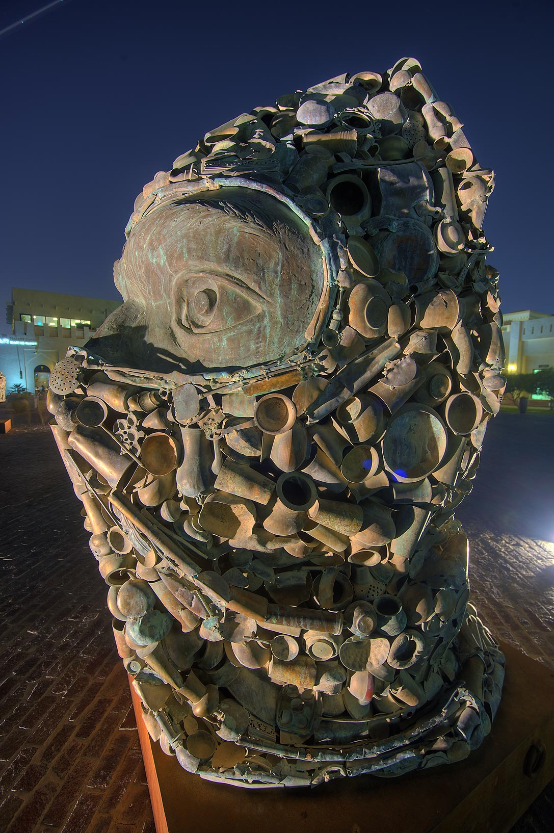 Subodh Gupta's Three Monkeys Sculpture (terrorist...Village at evening. Doha, Qatar