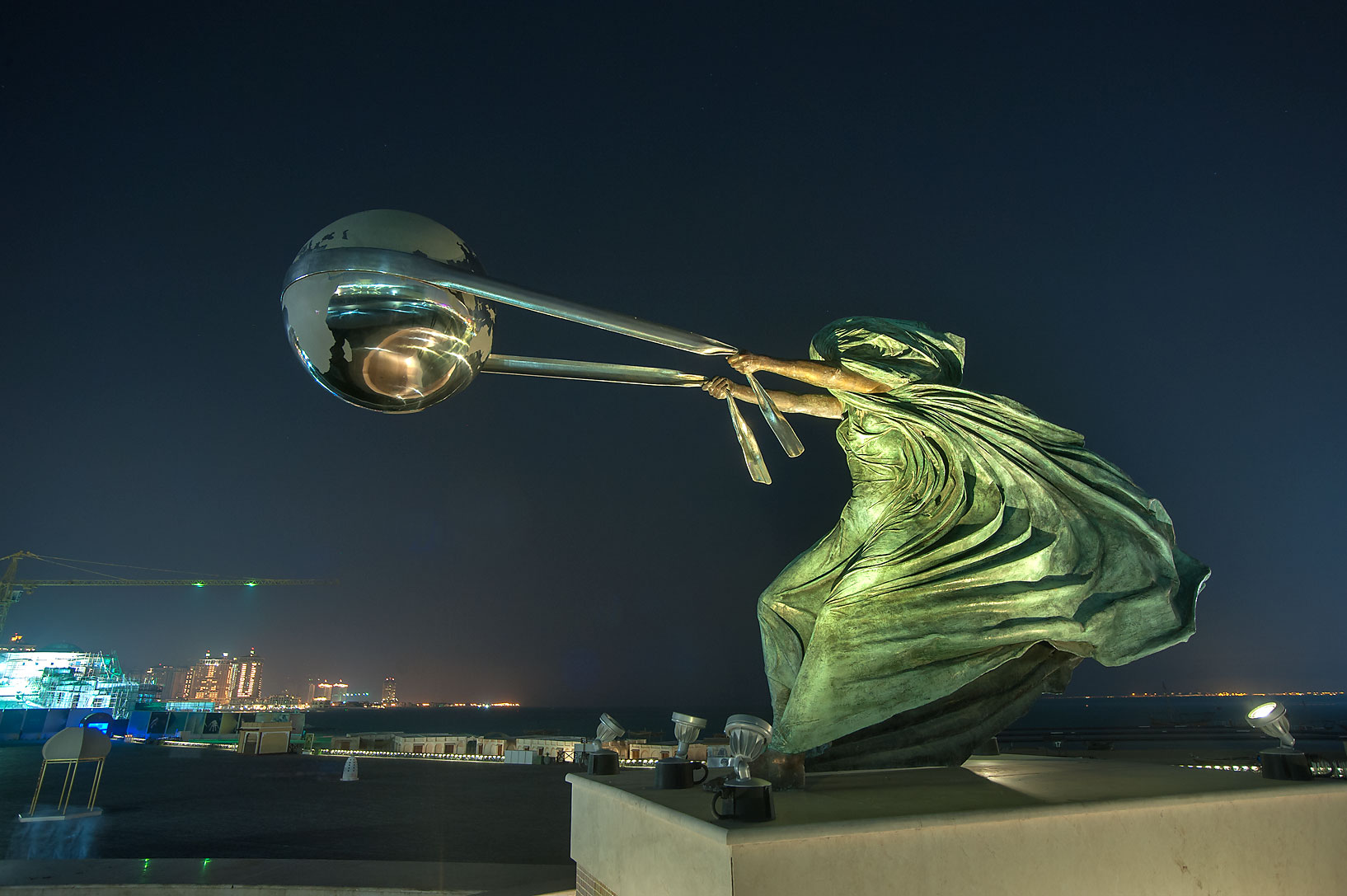 Harnessing the World sculpture in Katara Cultural...Amphitheater at evening. Doha, Qatar