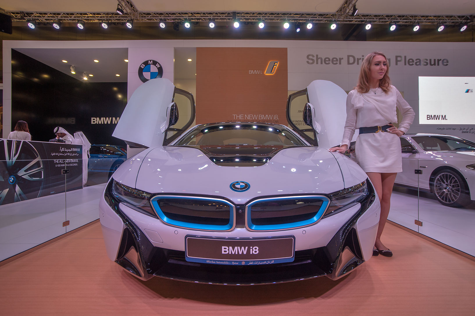 BMW i8 car with a feminine figure on motor show in National Convention Centre. Doha, Qatar