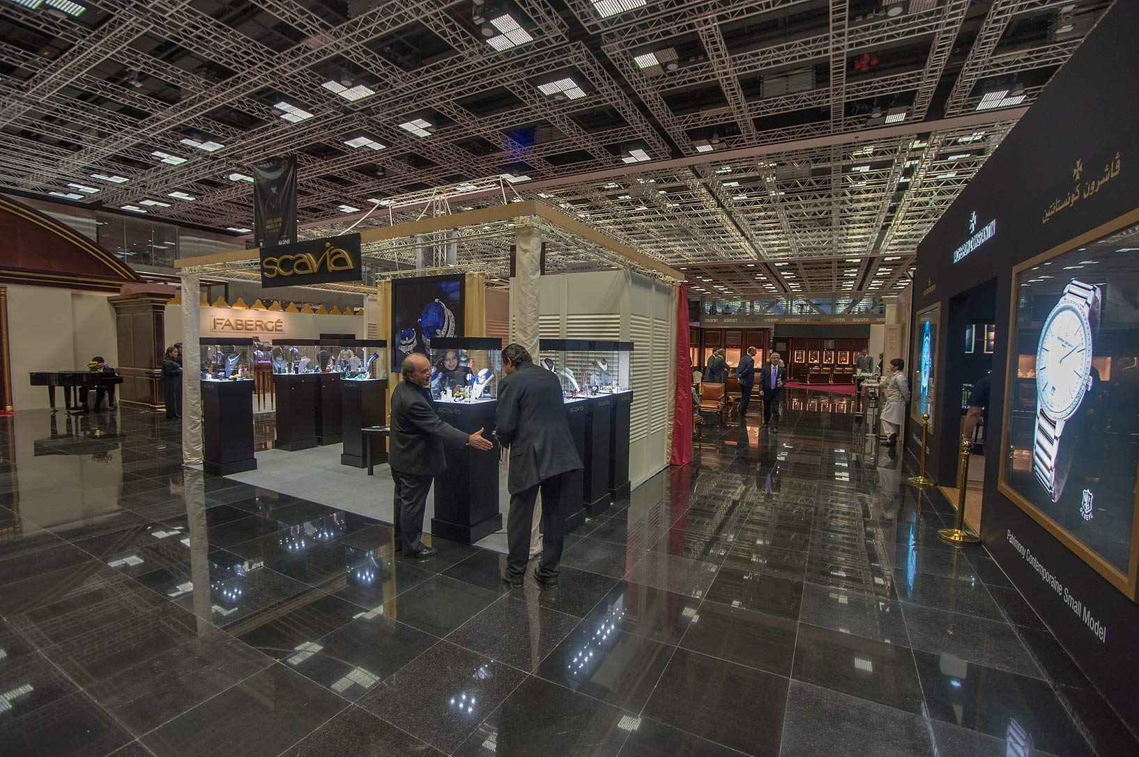 Handshake at jewelry show in National Convention Centre. Doha, Qatar