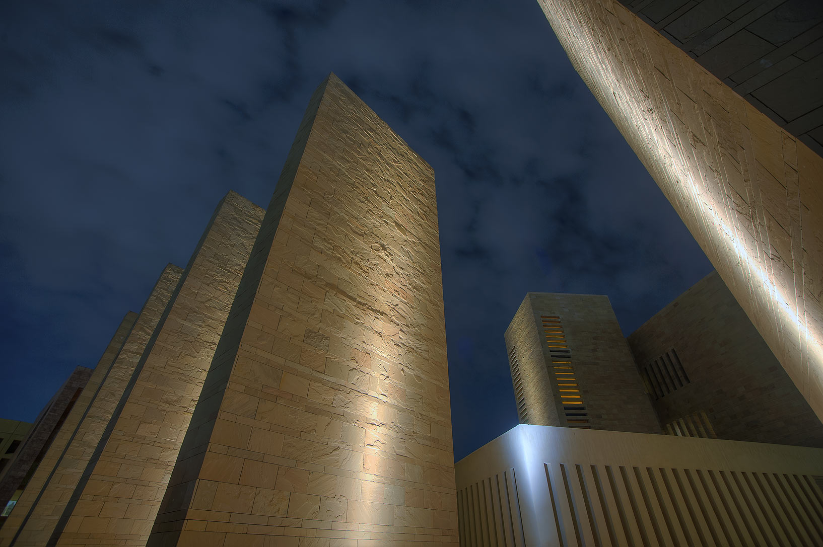 Stone obelisks behind Carnegie Melon University in Education City campus. Doha, Qatar