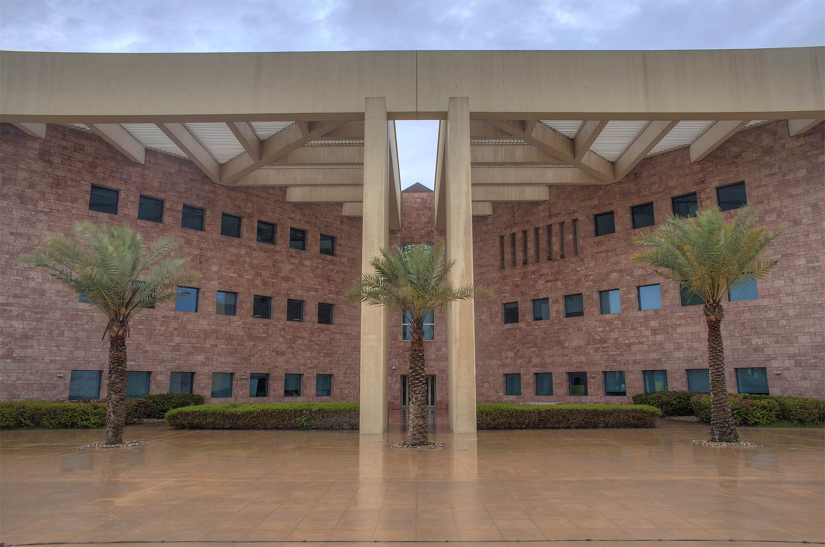 Side entrance of Texas A&M University in Education City campus at rain. Doha, Qatar