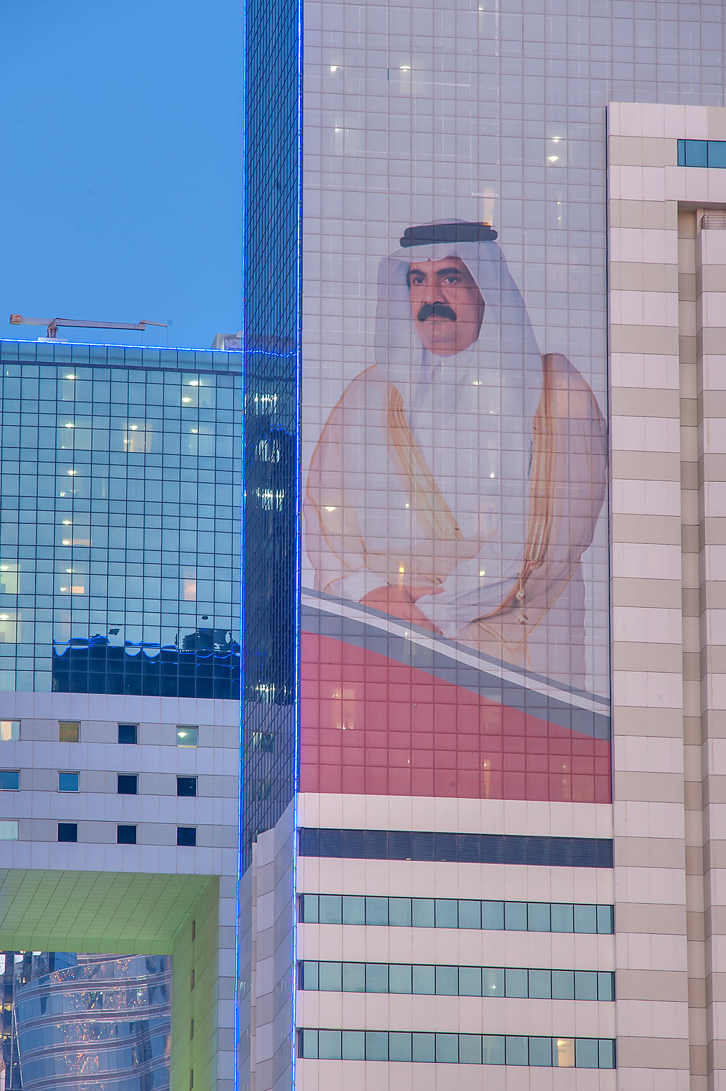 Giant portrait showing wise leadership of the...Al Adaid St. in West Bay. Doha, Qatar