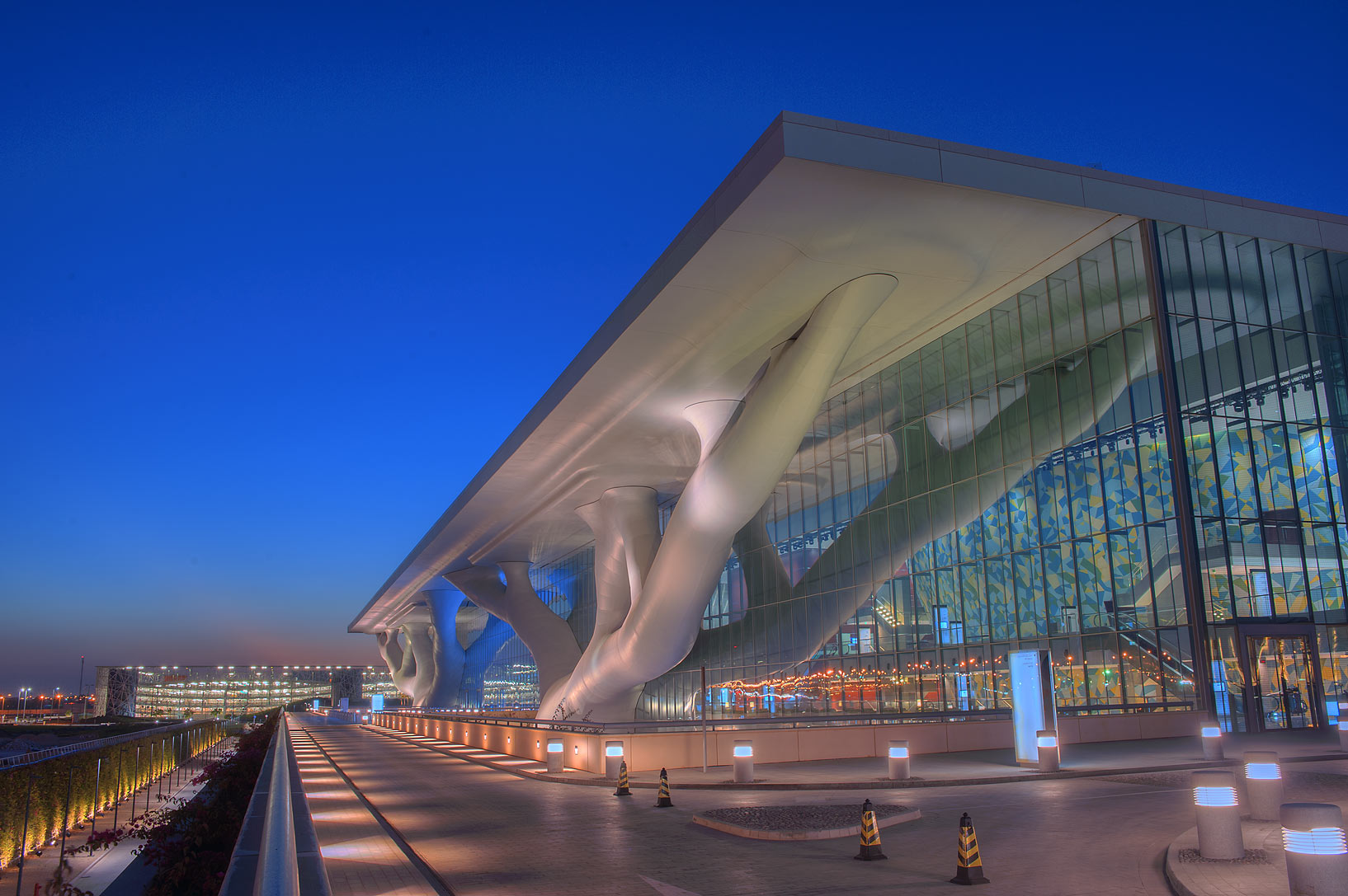 Entrance road of National Convention Centre (QNCC) at dusk. Doha, Qatar
