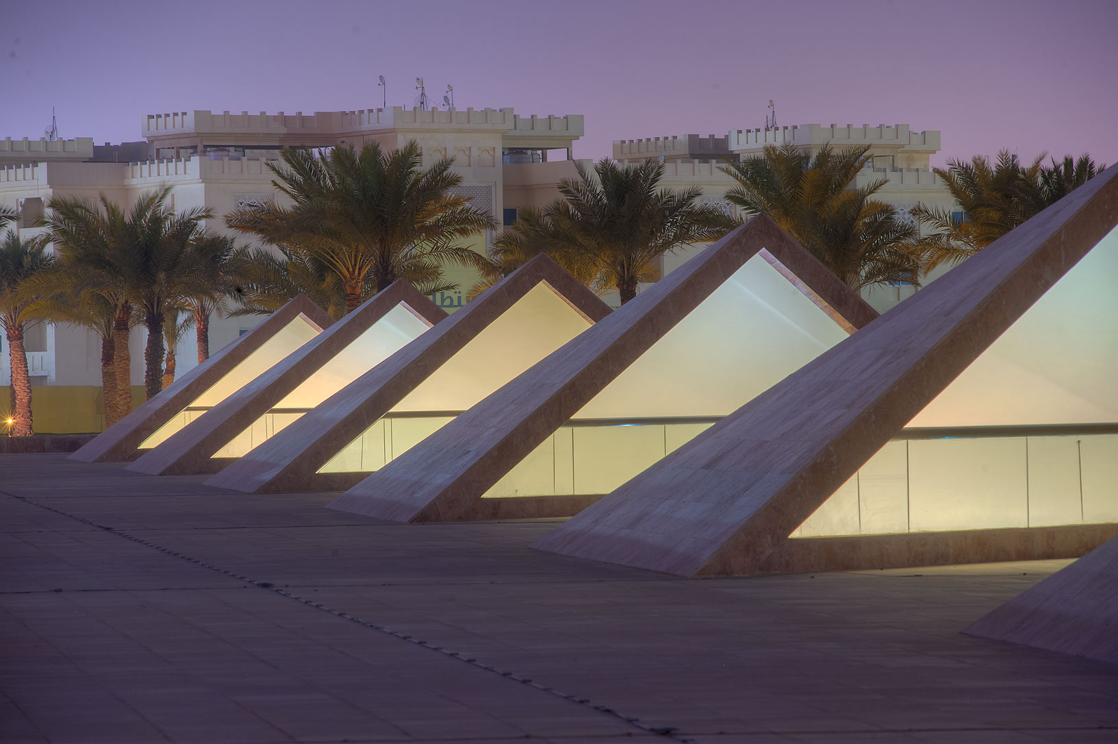 Row of barkhan structures of ventillation of...Education City at evening. Doha, Qatar