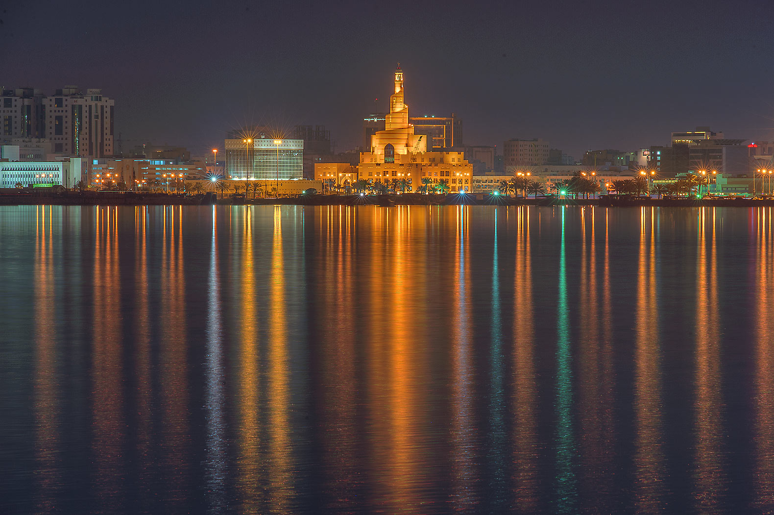 Reflection of spiral mosque from Corniche promenade. Doha, Qatar