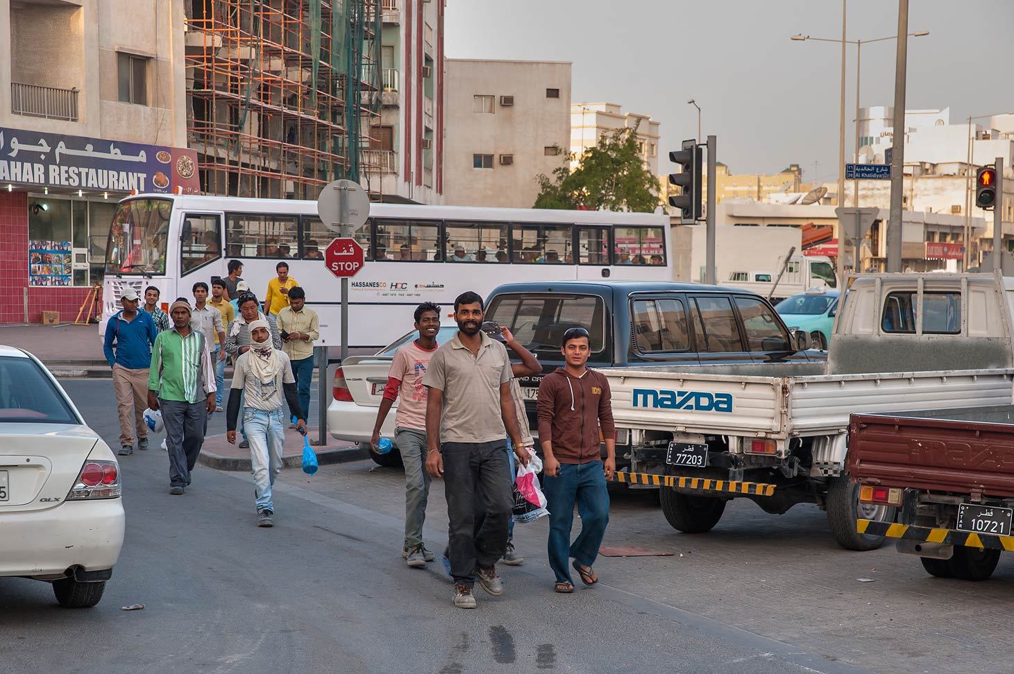 Workers on Al Kharaib St. in Najma area. Doha, Qatar