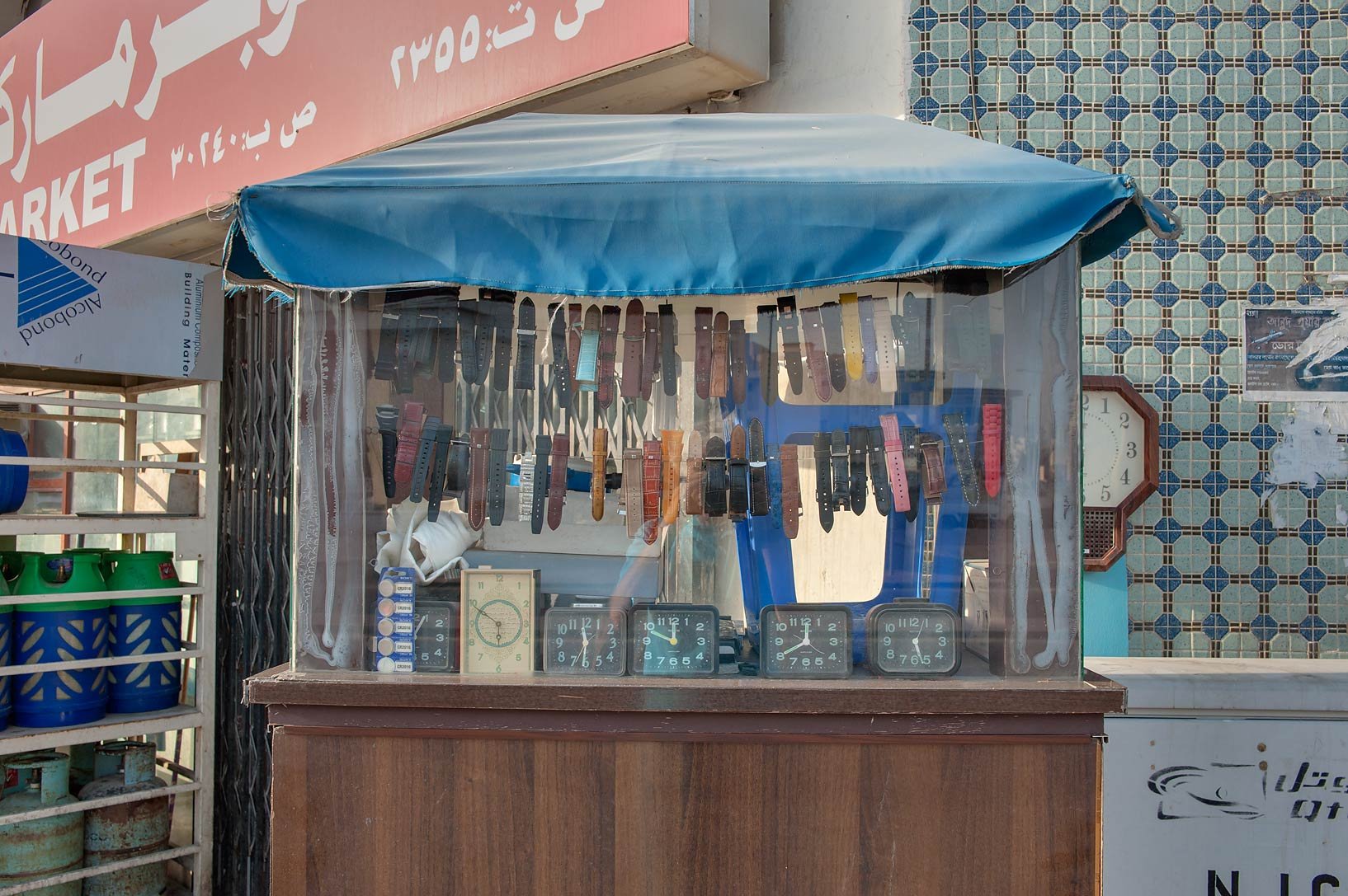 Watch repair kiosk on Al Mansoura St. in Najma area. Doha, Qatar