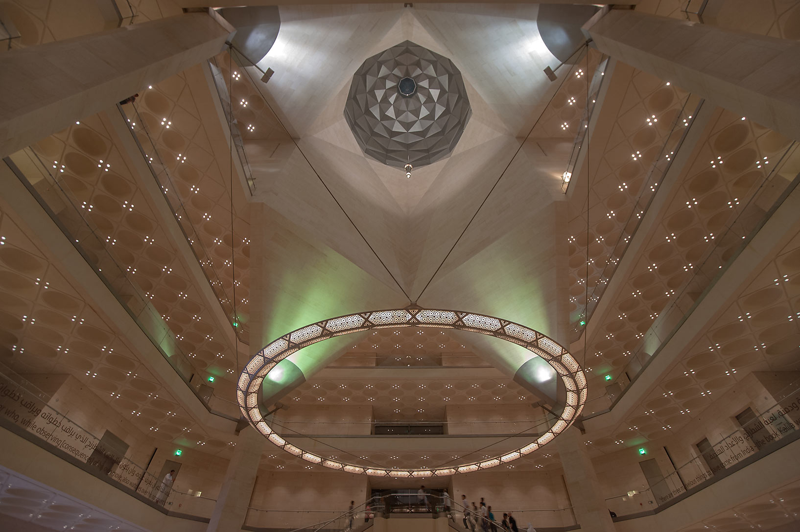 Wide angle view of perforated chandelier and a dome of Museum of Islamic Art. Doha, Qatar