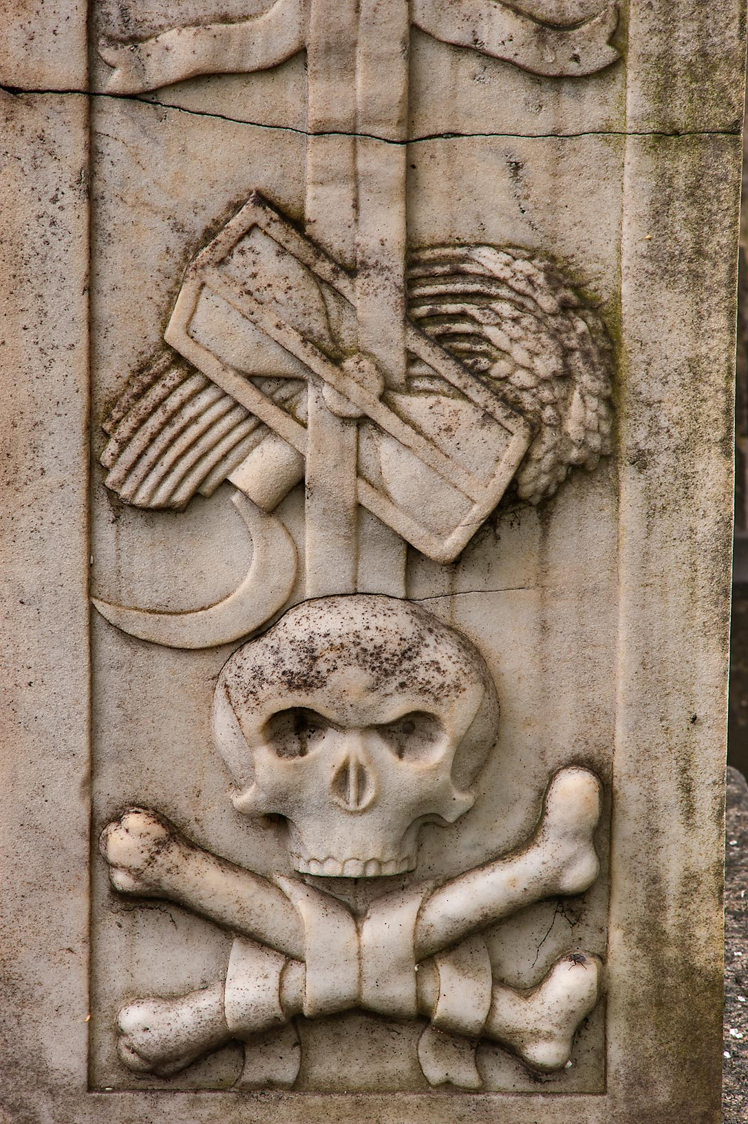 Marble skull and bones embossed on a tomb in...Cemetery). St.Petersburg, Russia