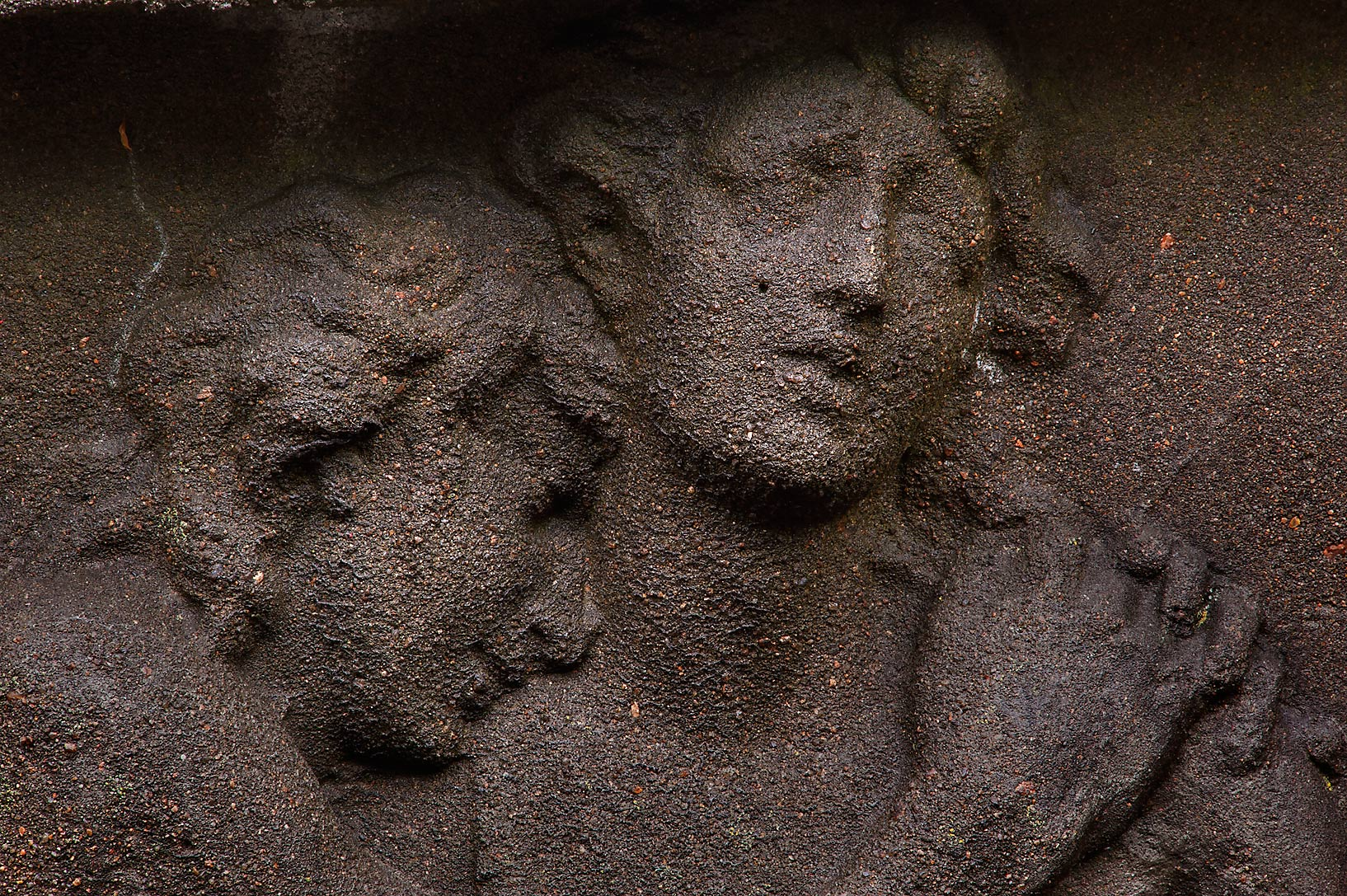 Clasping figures on a tomb in Necropolis of...Cemetery). St.Petersburg, Russia