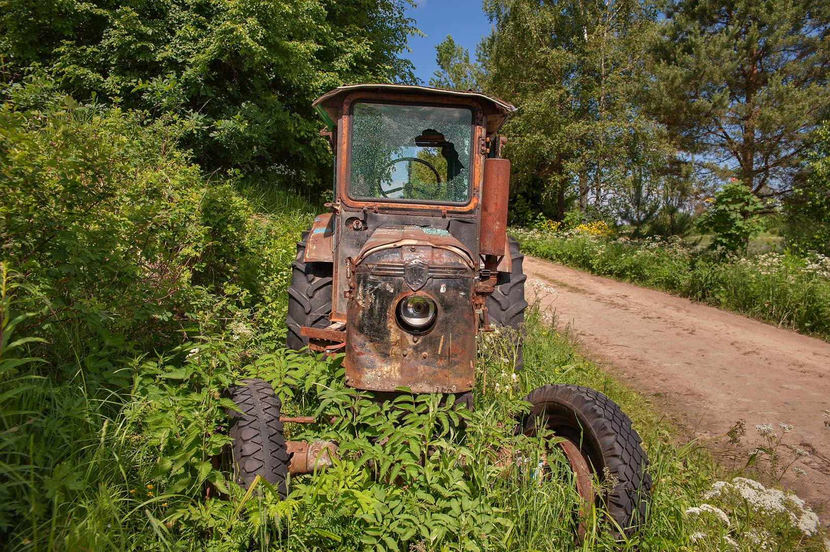 Old farm tractor near Novinka, 50 miles south from St.Petersburg. Russia