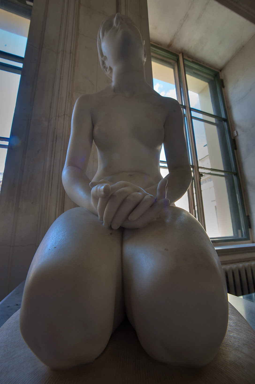 Sculpture of a woman with fat legs (Faith by...Museum. St.Petersburg, Russia