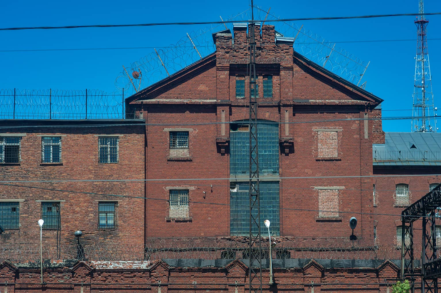 City prison from a window of a train. Vyborg, Russia