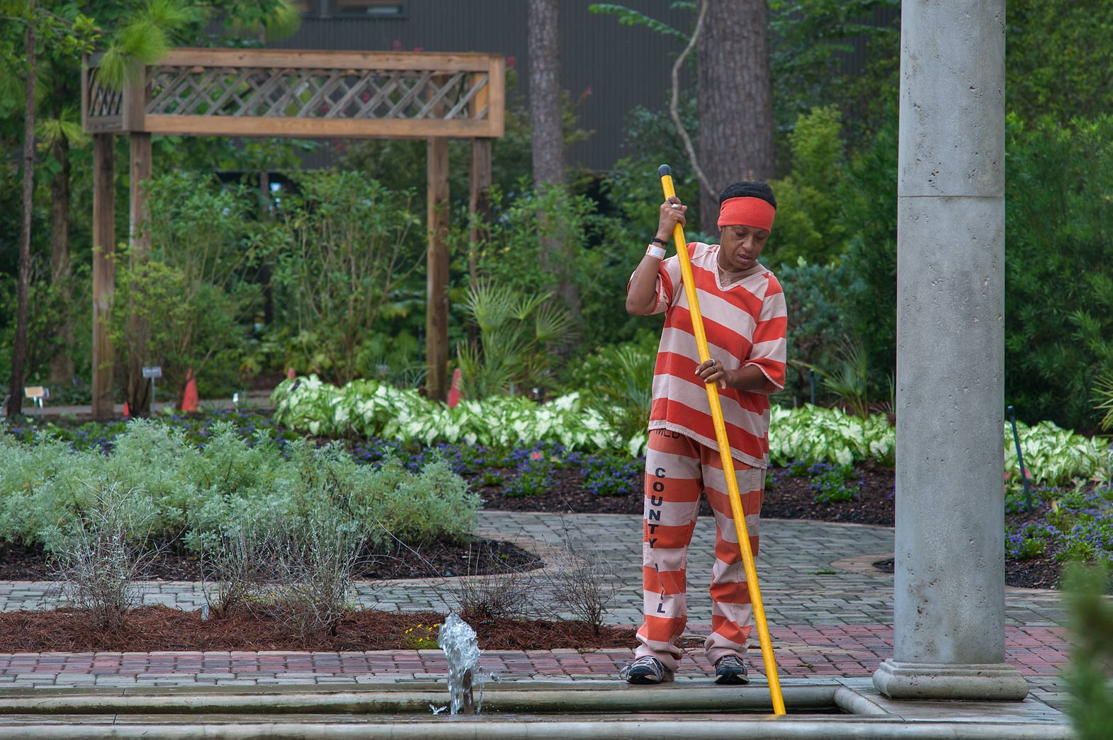 Prisoner taking care of flowers at morning in...Gardens. Humble (Houston area), Texas