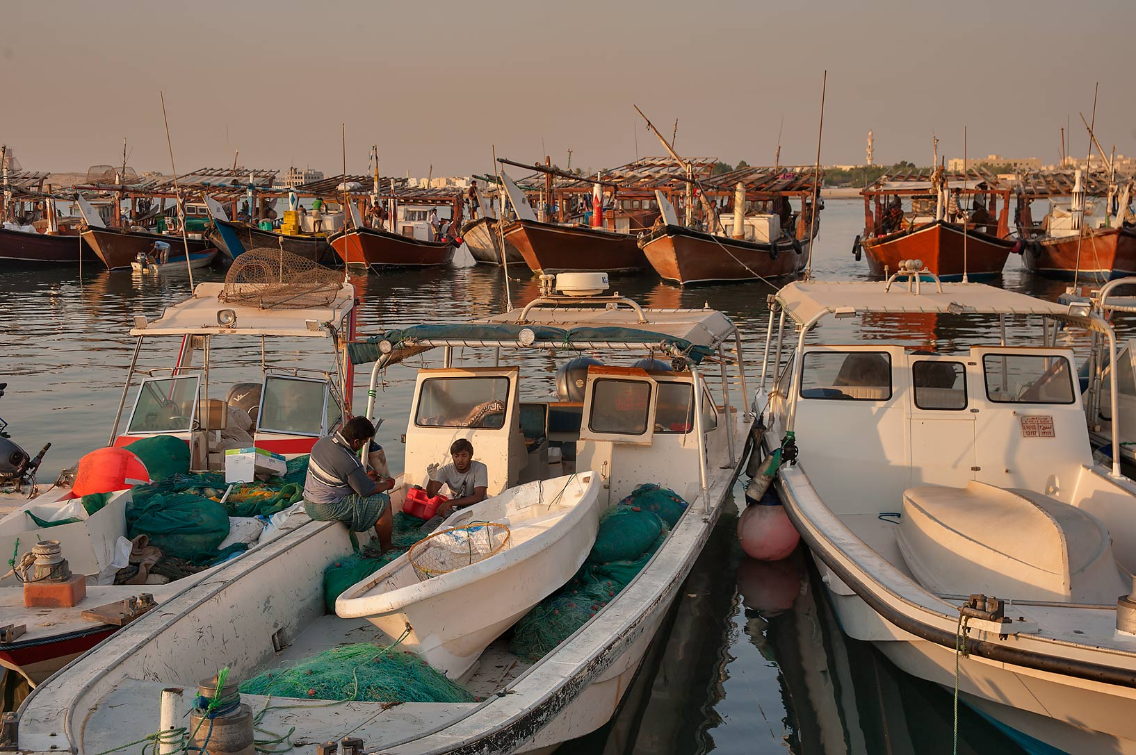 Various boats near a fishing pier at morning. Al Wakra, Qatar