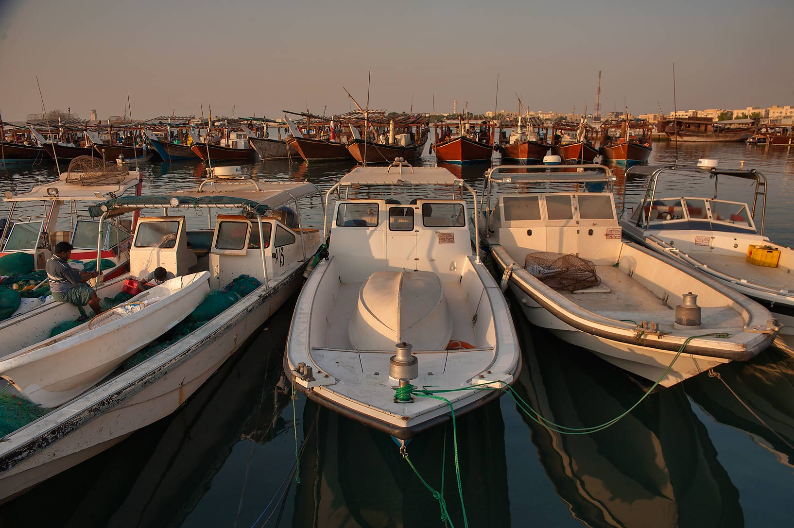 Boats near a fishing pier at sunrise. Al Wakra, Qatar