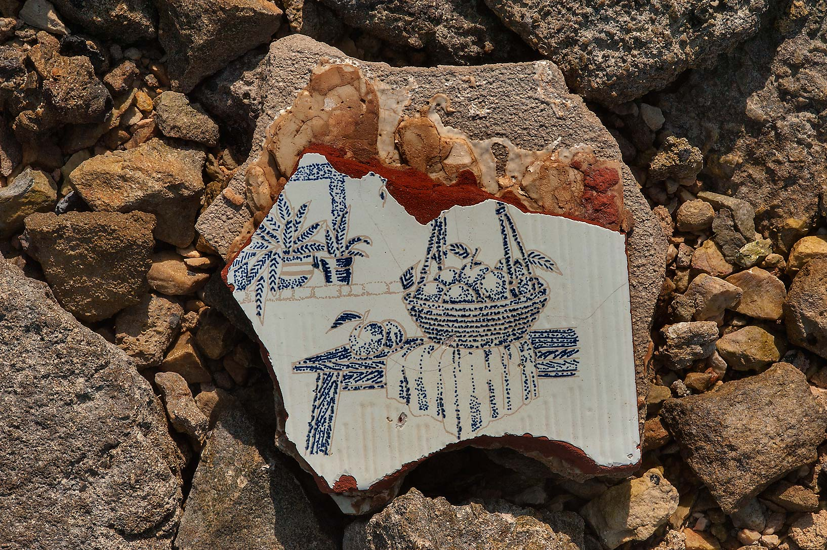 Remains of a ceramic tile on a beach in Ruwais. Qatar