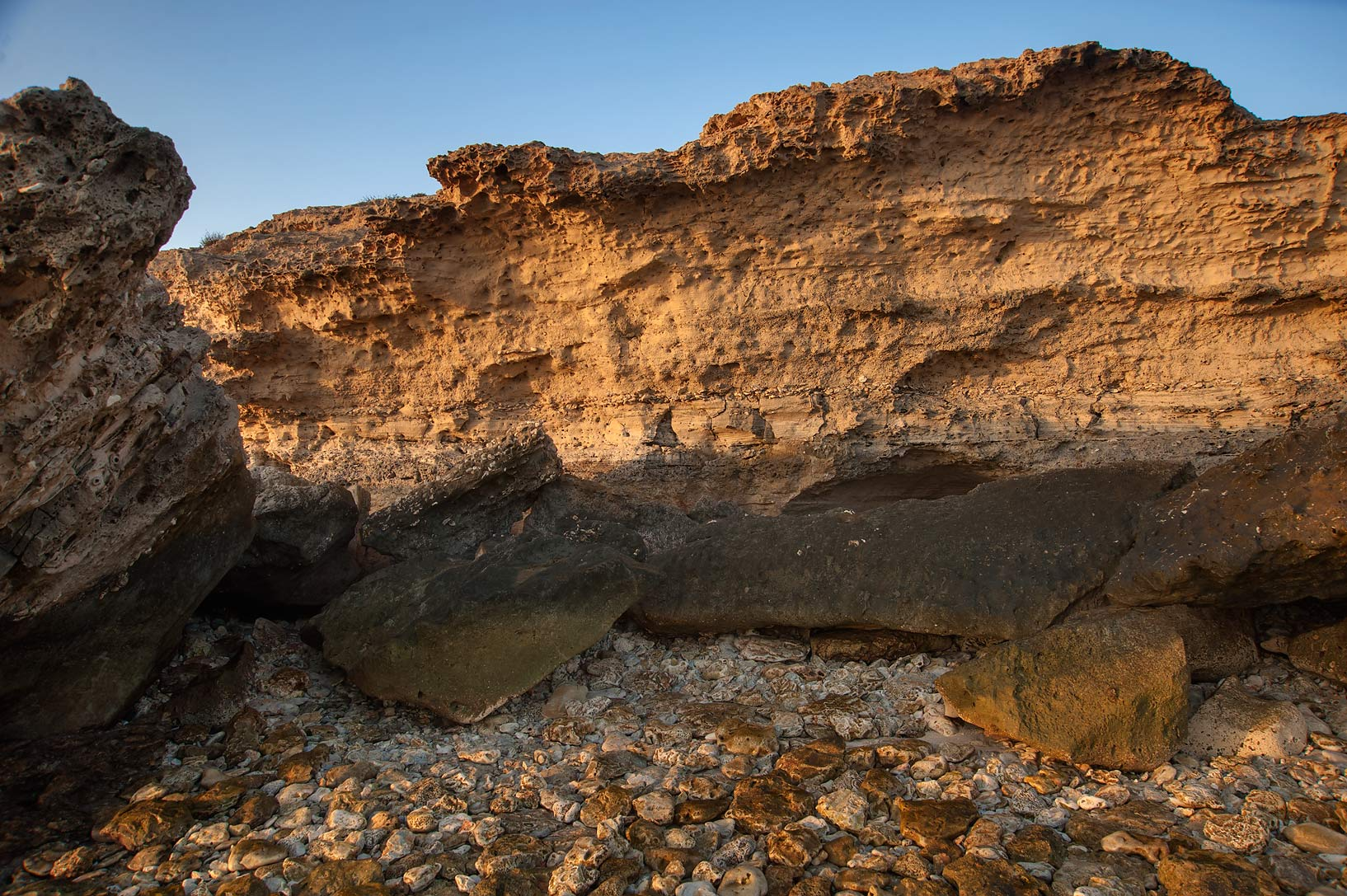 Limestone outcrops on a rocky beach near Jebel Fuwairit. Qatar