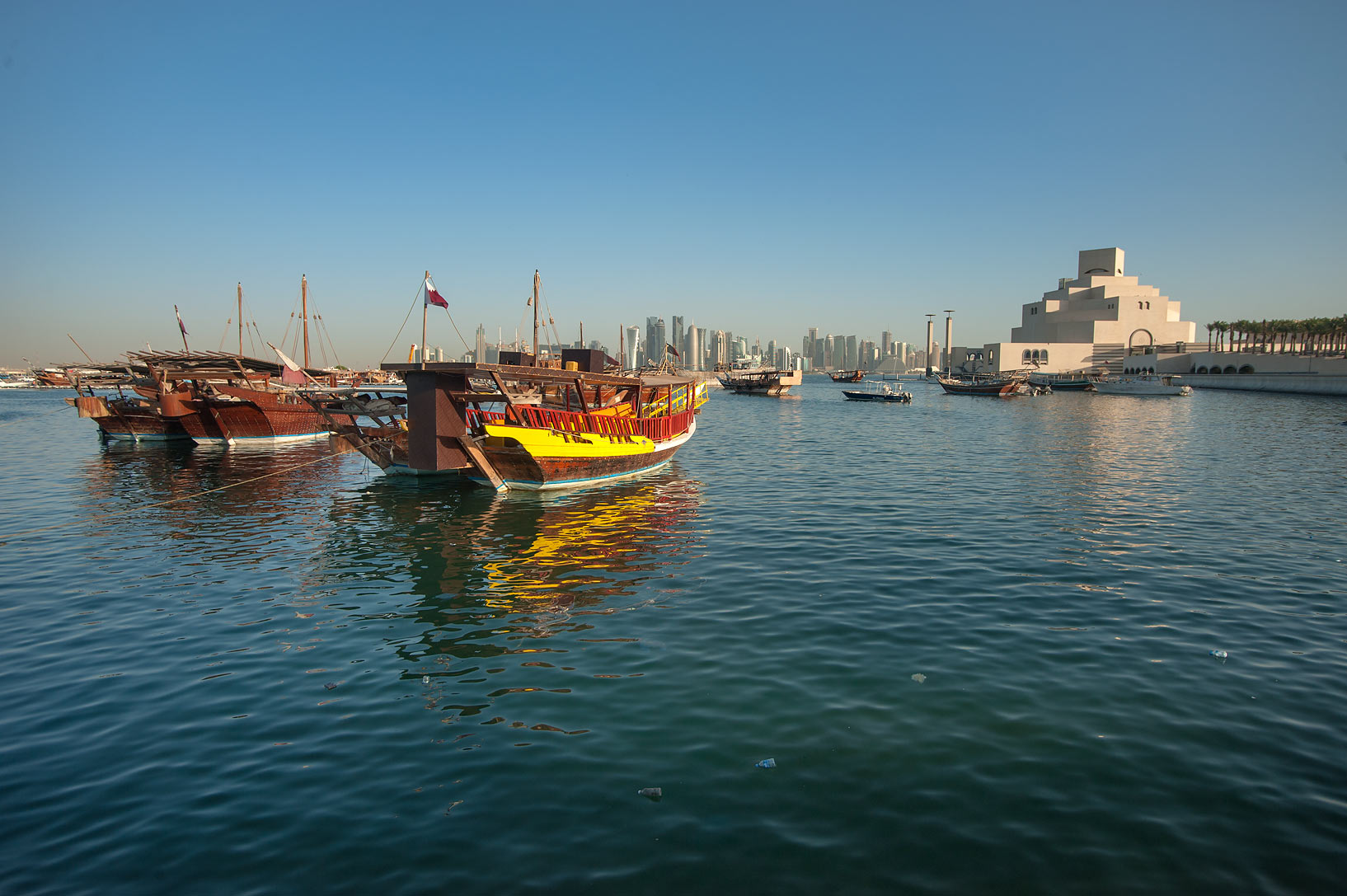 Dhow boats near Museum of Islamic Art from Corniche at morning. Doha, Qatar