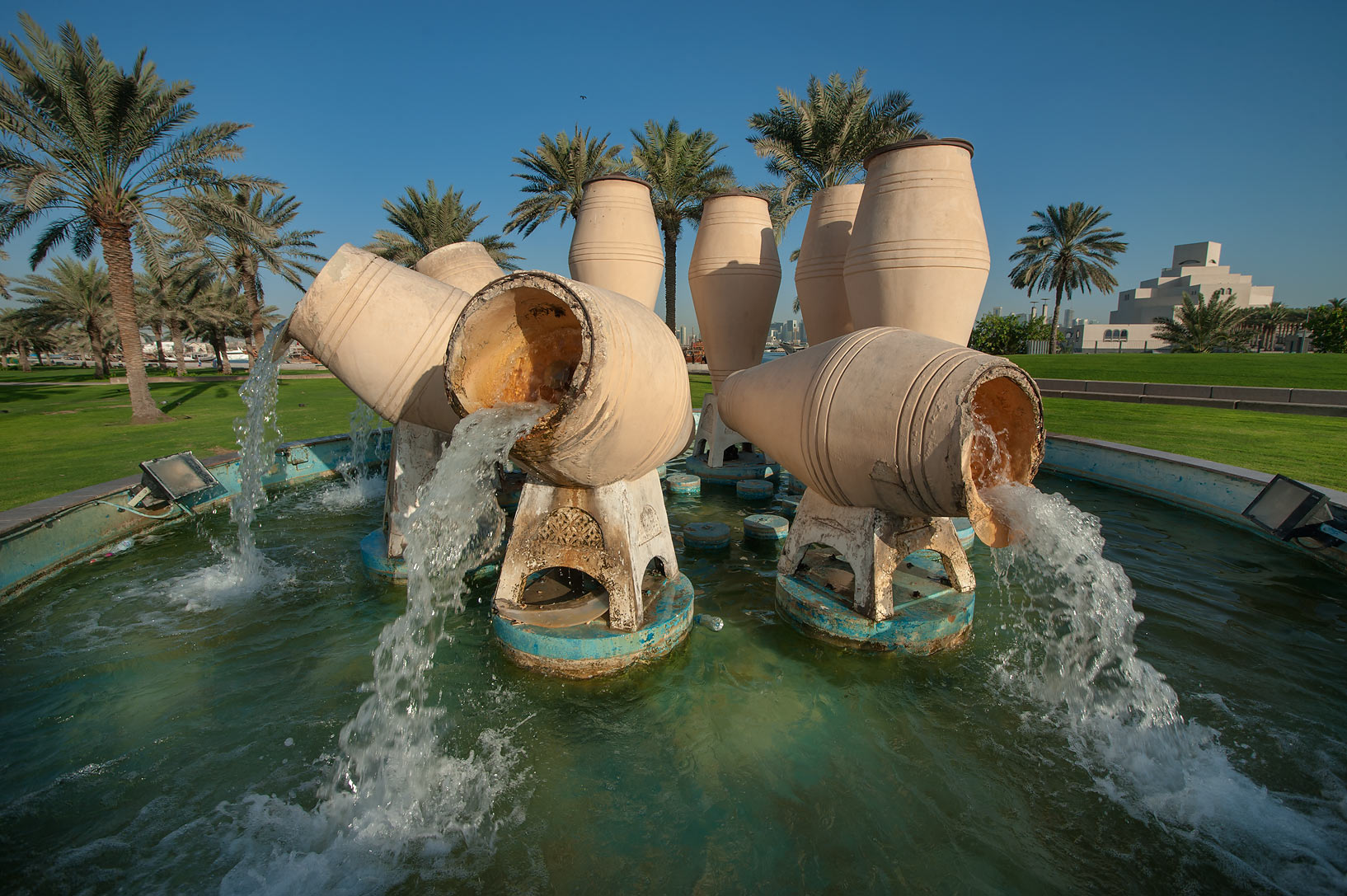 Water pots fountain on Corniche after sunrise. Doha, Qatar