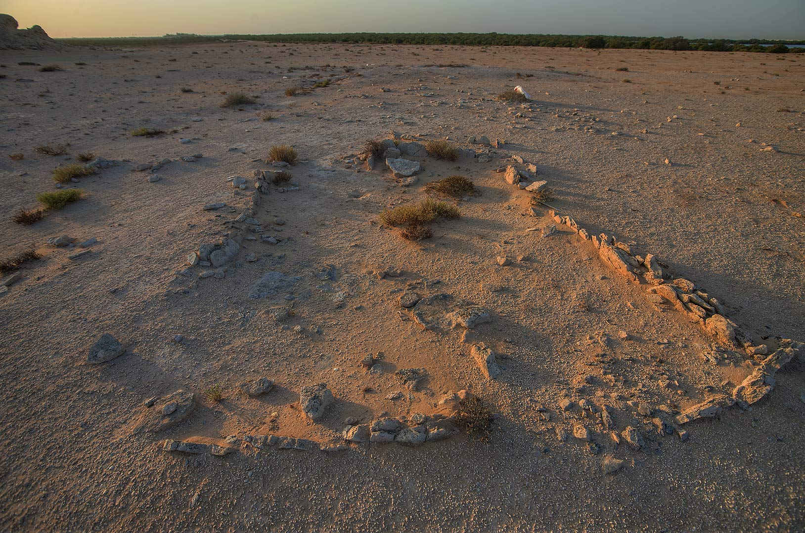 Remains of archeological excavations in Purple...Bin Ghanim) at sunrise. Al Khor, Qatar