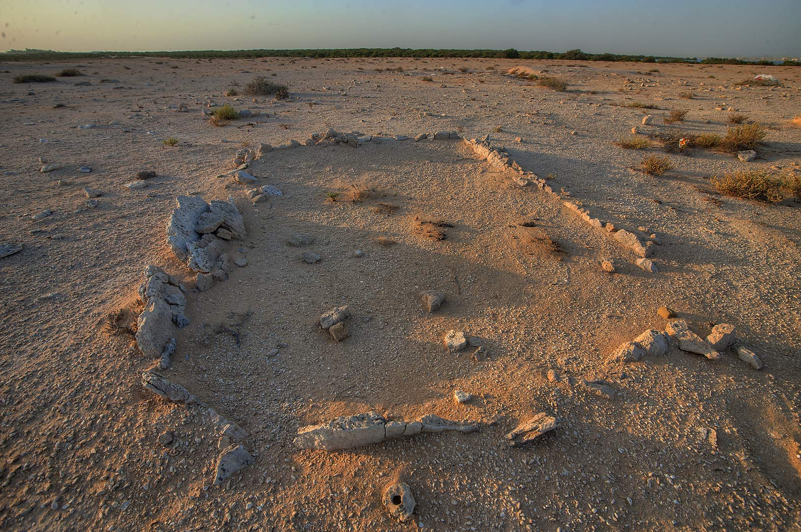 Remains of excavated antique walls in Purple...Bin Ghanim) at sunrise. Al Khor, Qatar
