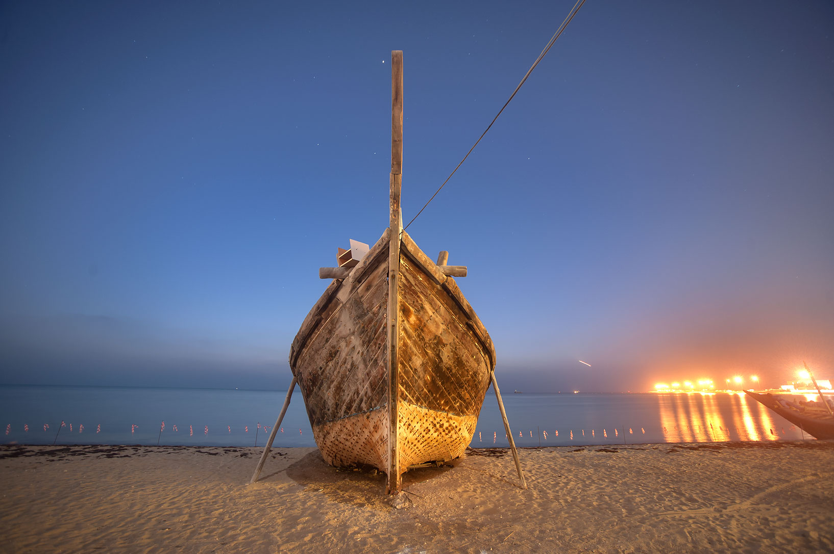 Beached dhow fishing boat at morning. Al Wakra, Qatar