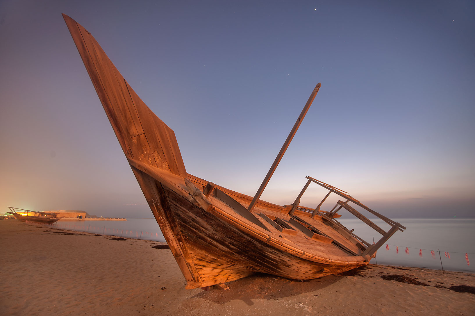 Beached dhow fishing boat at morning dusk. Al Wakra, Qatar
